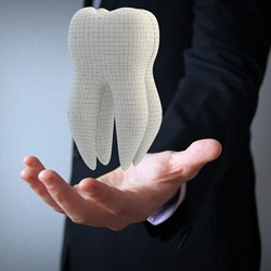 large tooth in hand