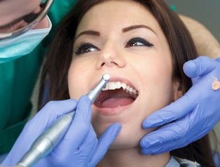 woman at dental cleaning