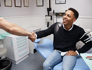man shaking hands with dentist