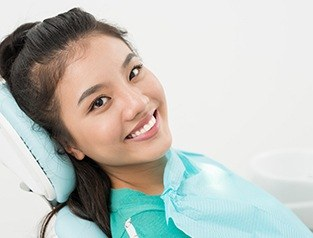 woman with dental cape smiling