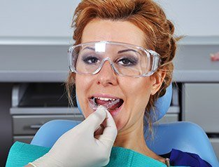 woman putting in oral appliance