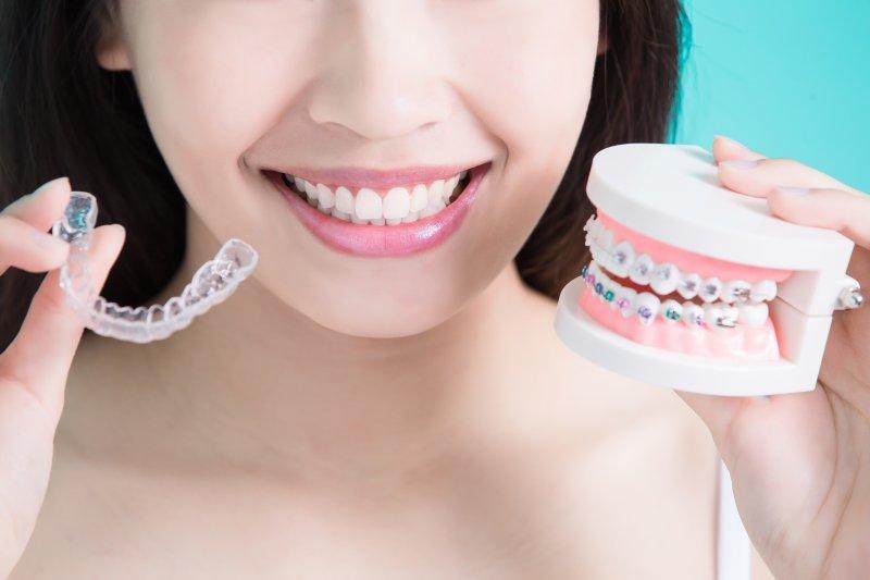 Woman comparing Invisalign vs. braces in Greenfield